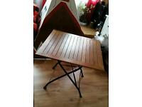 Garden foldable solid table with iron legs. Feltham