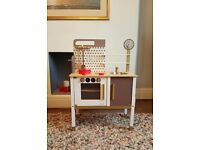 Janod wooden childs toy kitchen with food and utensils.