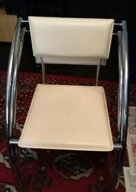 Two Cream Arm Chairs