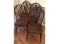 4 oak wheel back dining chairs