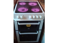 1 year old Ceramic 50 cm wide white cooker with hobs, grill.Excellent condition and clean. Delivery