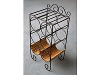 BRAND NEW black, wrought iron and wicker wine rack/holder. Holds six bottles.