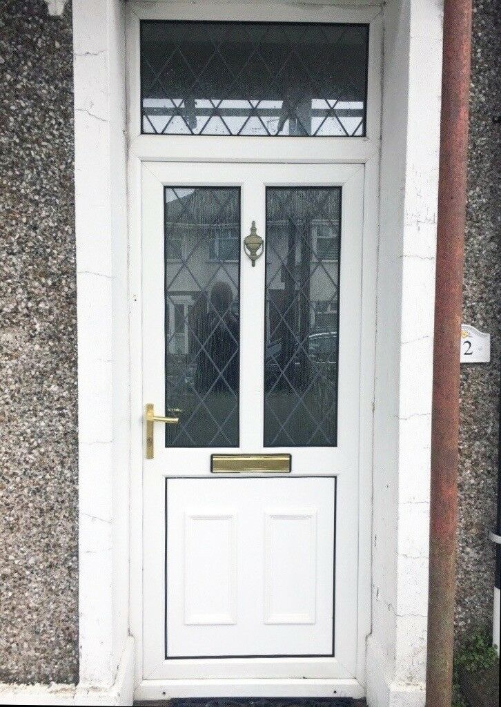 White upvc door with frame, fan light and keys in good condition ...