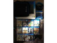 Playstation 4 with 11 games headset and carry case