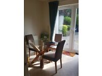 Used Harvey's glass square dining table and 4 chairs