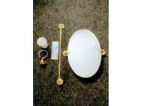 Oval mirror, towel rail and toothbrush holder