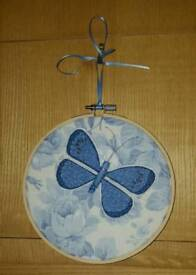 Embroidered butterfly in a hoop