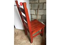 Solid wood stained chair.