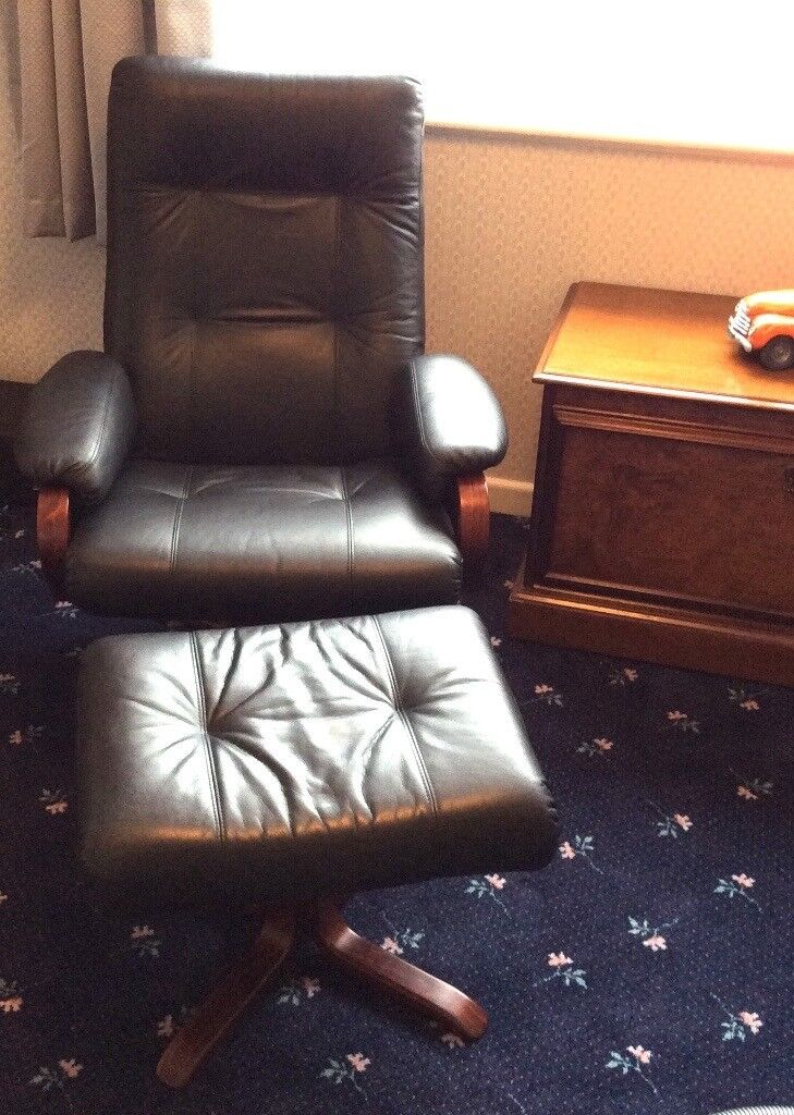 Beautiful Leather Chair and Stool featuring hard wood frame, arms and stool base