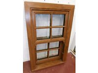 Sliding Sash UPVC WIndow in Cherry Oak Glazed
