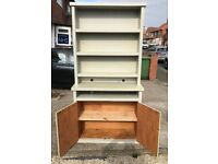 A LARGE PAINTED SOLID PINE DRESSER / WALL UNIT