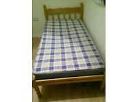 Pine single bed and mattress.