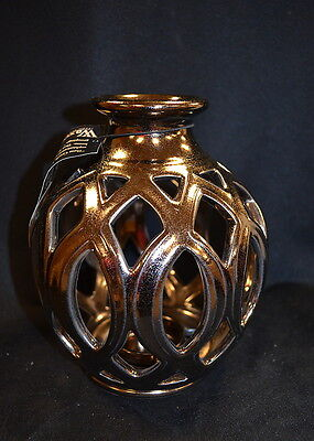 Bronze Glowing Candle Vase designed by Kevin Quinn