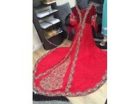 Asian bridal dress in a beautiful elegant satin red