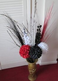 Pretty large FLOWERS in gold coloured decorative vase, red, black & white with matching decorations.