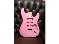 Stratocaster Shell Pink guitar body.
