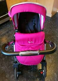 Wayfarer pushchair with rain cover and raspberry colour pack