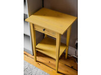 Elegant yellow bedside table