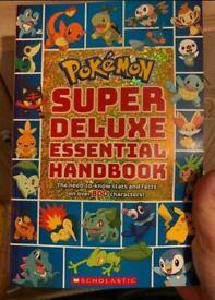 Super deluxe essential handbook Pokemon book.