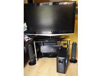 """Samsung 40"""" TV with DVD player and surround sound speakers."""