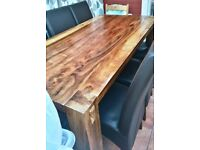 Solid Wood Dining Table and 6 Leather covered chairs.