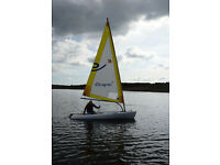 Escape 12 sailing dinghy with launching trolley.