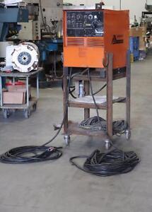 Acklands-Grainger SyncroWave 250 Tig Welder w/ a Metal Stand