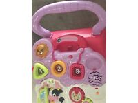 VTech first steps baby walker in pink has barely been used and is in immaculate condition.