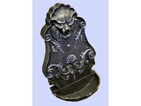 Ornate hand crafted cast iron lion head water spout and trough with gold metallic patina.