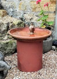 Small terracotta bird bath