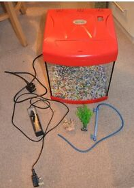 Red Fish tank with some accessories ( Filter, gravel, plant) 25 litres