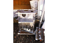 Free metal from old boiler, ideal for parts or scrap metal. Has a resell value