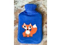 Hot water bottle with fox cover