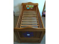 Solid wooden cot bed with clean mattress 140x70cm in good condition