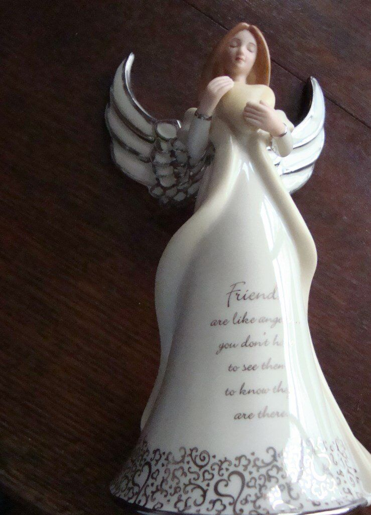 "Porcelain ""Friendship"" Angel Figurine Music box."