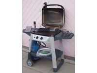 Barbecue. 2-burner OUTBACK model with hood, very good condition. Also very well equipped.
