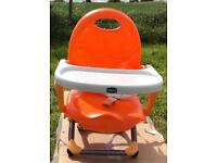 Child's high chair with tray.