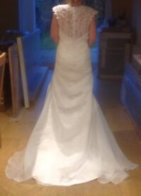 Wedding dress and under skirt size 12. Never worn.