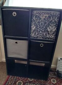 Black cube storage unit with 4 free fabric boxes