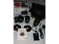 Canon 1100D digital SLR with 55-70 lens plus Sigma 70-300 Zoom lens