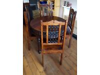 Indian style dining room table and four chairs