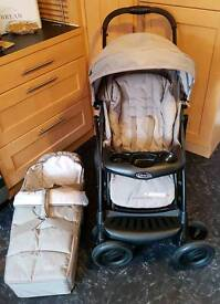 Brand new Graco with carrycot pushchair travel system