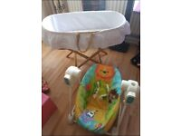 Moses basket and swingin chair also a baby mat