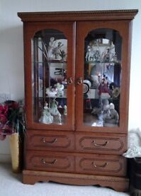 Glass fronted/sided display cabinet with 2 drawers