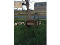 A vintage cast iron agricultural mangle