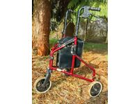Folding three-wheeled walker with brakes and bag
