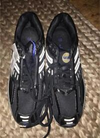 Men's trainers, 1 black and 1 White pair with tags