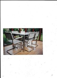 Perring table (5ft x 3ft) and 6 chairs in grey and chrome. In v.g.c. Offers