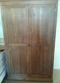LIGHT SOLID OAK DOUBLE WARDROBE AS NEW CONDITION NOT BEEN USED.