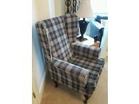Checked high back winged chair
